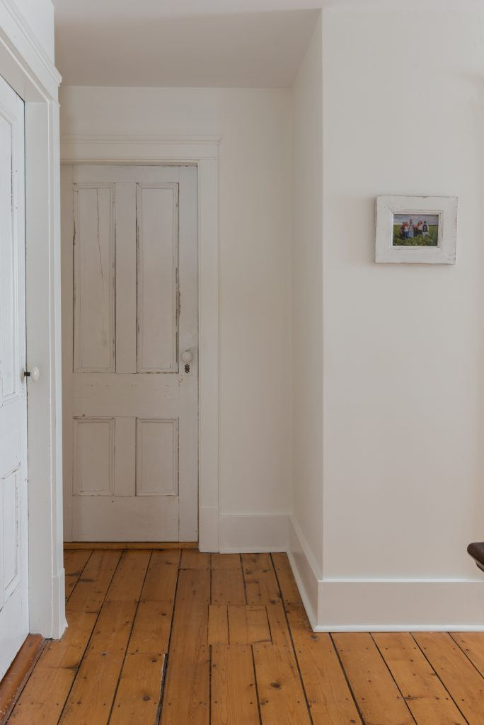 farmhouse hallway with original farmhouse doors