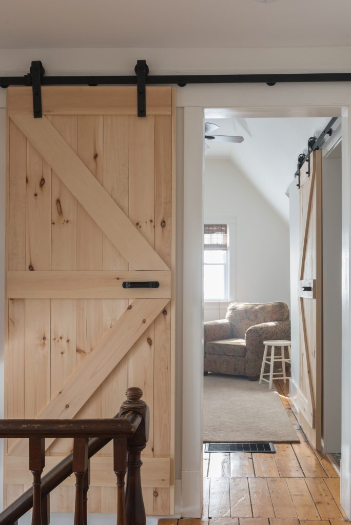sliding barn door and cast iron rail family room
