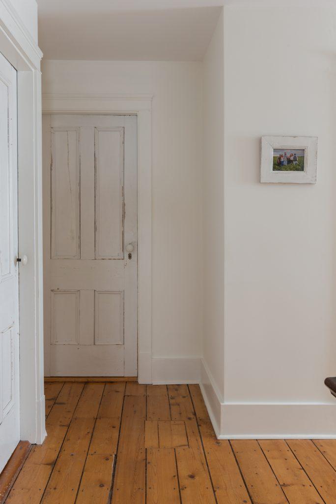 farmhouse hallway with original farmhouse doors