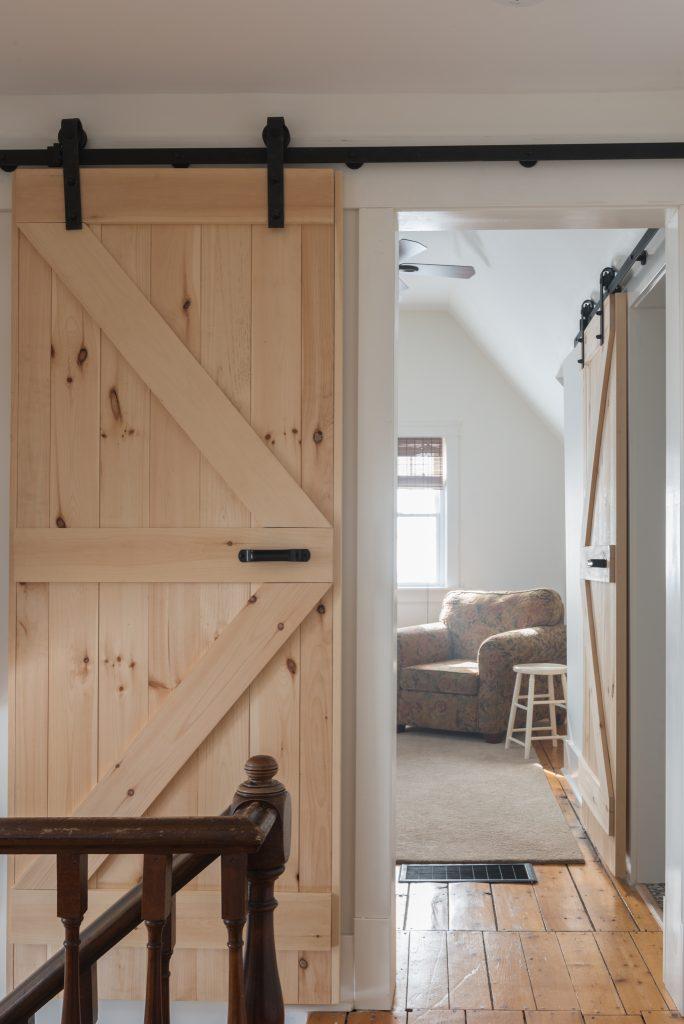 sliding barn door and cast iron rail family room