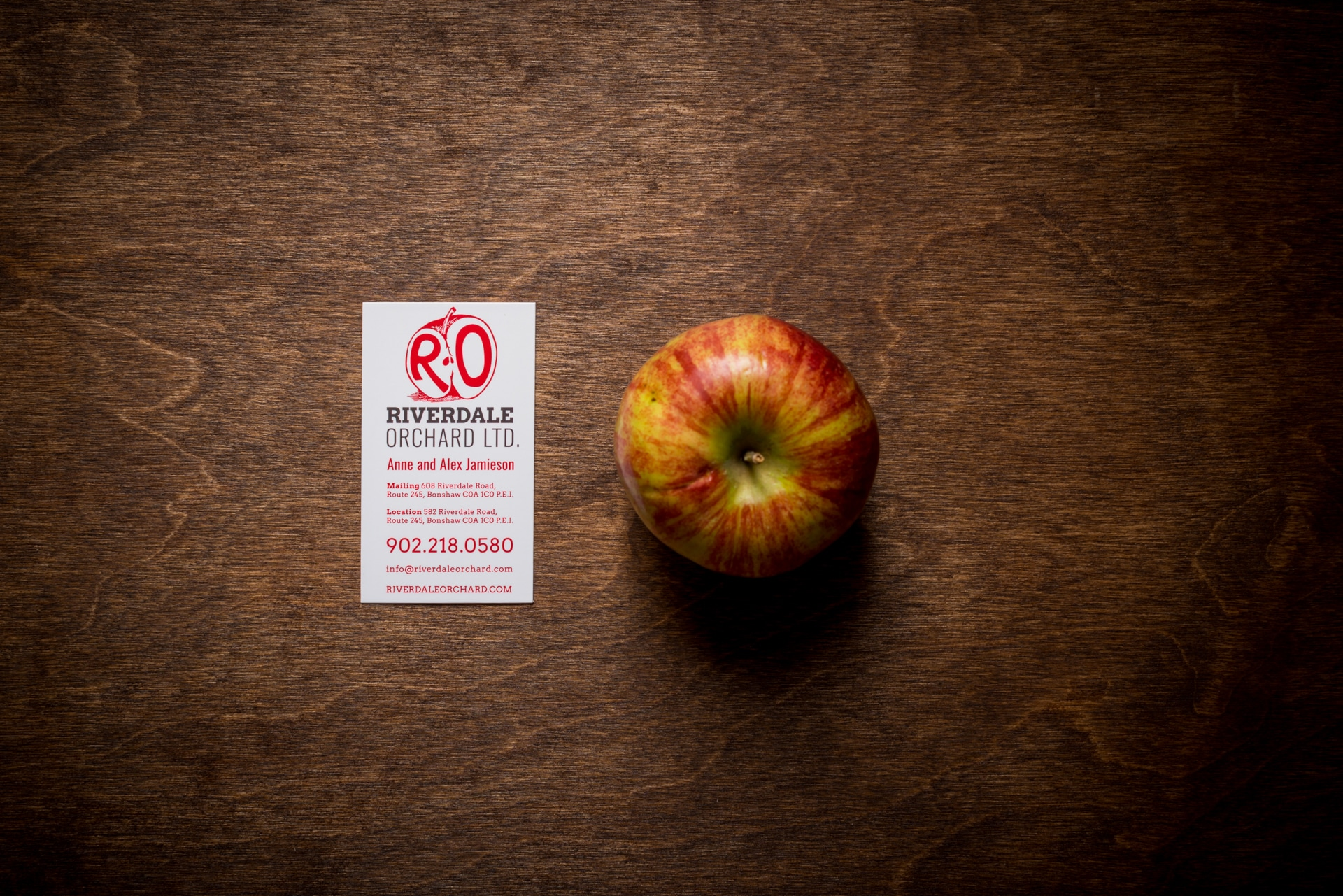 Riverdale Orchard business card and apple